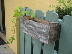Pallet fence as air conditioner cover