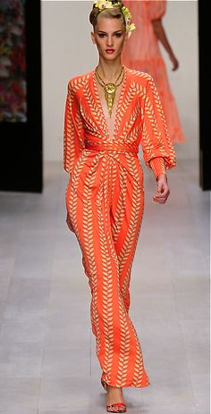 Tangerine twist with a hint of gold bursting outward...I imagine a runway of such led by you.