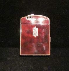 1940s cigarette lighter and case