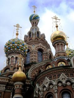Look up! The dramatic domes of St. Petersburg's Church of Our Savior on the Spilled Blood gleam against a blue sky.