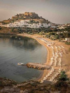 Picture of Rhodes main beach with the acropolis sat majestically above. This photo was taken after a sunrise shoot in Lindos on the wonderful Greek Island of Rhodes. #lindos #rhodes #mainbeach #sunrise #greece #greekislands #rickmcevoyphotography #olympuscamera