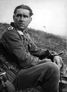 Portrait of a German Wehrmacht Oberfeldwebel  following the Third Battle of Kharkov, which was a series of battles on the Eastern Front, undertaken by the German Army Group Southagainst theSoviet Army, around the city ofKharkov between 19 Feb 1943 and 15 Mar 1943. The German counterstrike led to the destruction of approximately 52 Soviet divisions and the recapture of the cities of Kharkov and Belgorod. Kharkov Oblast, Ukraine, Soviet Union. April 1943.