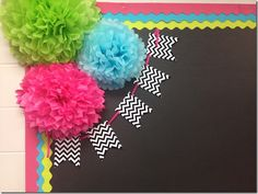 photo of a cute way to decorate the corner of your bulletin board...I have these hanging from my ceiling in my classroom.