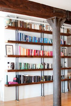 {Reclaimed Hardwood Bookcase} rustic/modern style - love the books-by-colour display, too!