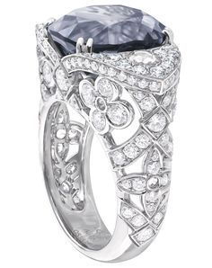 @Louis Vuitton 'Voyage dans le temps' Dentelle de Monogram ring. The grey blue spinel of just over 11 carats and the grey diamonds echo the dark of outer space.