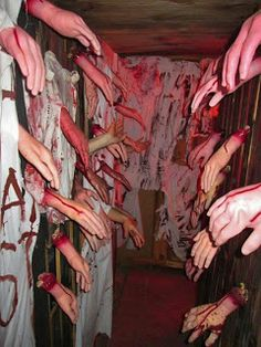 Hallway of Hands. Hoping a few strategic ones are real..~.Did this idea in the 80s at a school haunted house fundraiser. Couldn't get any more kids to walk through it after the first couple victims were grabbed & terrorized. No one else would enter the 'Hall of Hands' .