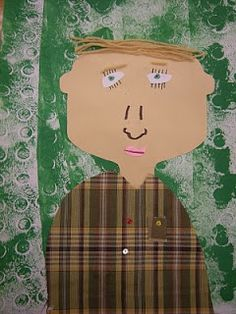 1st grade- really cute symmetrical self portrait with printed background