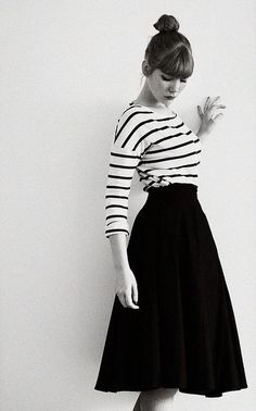 Love. Simple black and white stripes with bold black high waist skirt. Bangs.