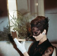 Audrey Hepburn wearing black lace mask on How to Steal a Million, 1966