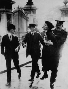 Emmeline Pankhurst (15 July 1858 -14 June 1928) was the leader of the British suffragette movement. Opposed to Pankhurst and the concept of women being allowed to vote, were of course most men and most institutions; including the Church of England & British Royal Family. In protest, Pankhurst and other women chained themselves to the railings outside Buckingham Palace. Photo shows her being arrested and taken away by police. She never gave up, and in 1928, women won the right to vote in the UK.