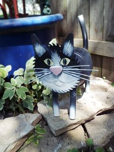 Cat made of recycled Pots, PVC, Saw blade. Makes a great addition to any garden. http://www.facebook.com/pages/Wonders-In-wire