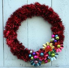 This Vintage Bulb Reflector and Tinsel Wreath is just too much fun! It's the perfect way add a pop of color to your front door.