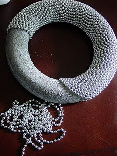 A pearl wreath...lovely! With a gorgeous, elaborate bow made of gorgeous material.