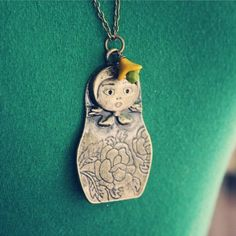 nesting doll necklace. cute!