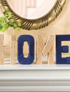 Yarn wrapped and paper mache home decor statement letters add a touch of fun to any room.