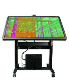 The Presenter 55 touch wall (and table!) supporting 32+ touch points on a motorized stand.
