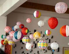 Balloons, paper lanterns & paper honeycomb balls mixed in fun colors and/or prints -- use coordinating colors to a theme to accent other decor!