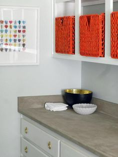 See how blogger Jenny Komenda, an interior designer, gives her laminate laundry-room counters a concrete-look.  And visit her other projects at littlegreennotebook.blogspot.com | thisoldhouse.com