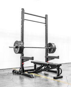 rouge squat rack...plus bar with rubber plates.