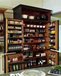 RePurpose a giant old tv armoire or entertainment center into a quaint pantry.  Add more shelving for great storage.  Recycle!  Upcycle!  Salvage!  For ideas and goods shop at Estate ReSale & ReDesign, in Bonita Springs, FL