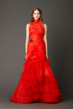 Vermillion strapless mermaid gown with inverted flange bodice andcrystal embroidered floral detail skirt