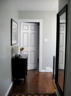DIY two-tone doors--taped off and painted with the same gray color – Stonington Gray by Benjamin Moore- that is used on the walls to accent the six panel detailing