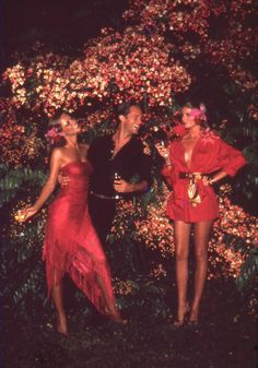 Photo by Helmut Newton, 1970's. I guess this is where Marc Jacobs got his inspiration for his Spring/Summer 2011 show. The flower accessories, the colors, the belt and silhouettes....