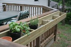 Plant herbs in wooden boxes off deck