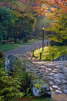 David Cobb, Stone Bridge: A stone bridge and pathway during the month of October at the Seattle Japanese Garden.