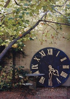"""From Vogue Living 2006.. """"Time's passage...a clock face from a town hall in Montpellier, France, leans against a courtyard wall where falling leaves from a 17-year-old tulip tree mark the approach of autumn."""""""