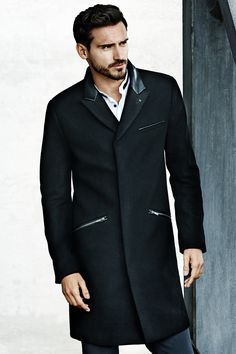 This season is all about balancing tailored cuts and punk vibes. Give your office ensemble edge or elevate your casual look with this effortlessly-cool coat. Coat in a wool blend with imitation leather details.│ H&M Men.