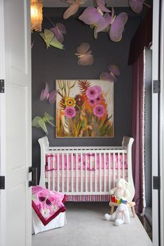 Dark charcoal grey (not to mention giant butterflies!) is a bold choice for this otherwise traditional space.