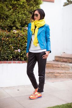 Aimee Song of Song of Style wearing an qua moto jacket, a yellow scarf, and bright NewBalance sneakers // #Spring #StreetStyle