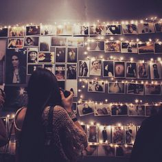 Photo wall. like the idea of combining fairy lights with the pics. So sweet.
