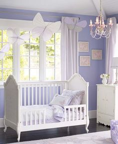 What a pretty butterfly bedroom for little girls. I love the combination of white and purple. The hanging butterflies and the chandelier are nice decorative touches. butterfly bedroom, butterfli bedroom, toddler bedrooms for girls, girl room, toddler room, crib, color, girl nursery butterflies, baby room butterflies