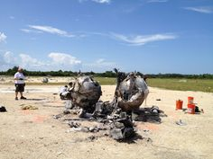 Morpheus lander debris.  Look at the tank that was blown into the background, to the right of the big guy.