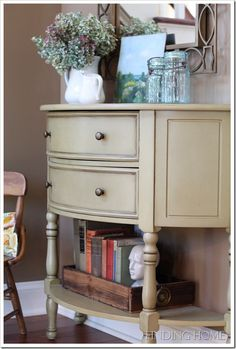 I like the old drawer used to hold books, and the white pitchers. We have plenty of mirrors, should be able to recreate this look as soon as we find an old drawer :)