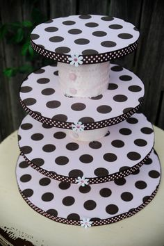 Could make with cake cardboard rounds, scrapbook paper, and cans?