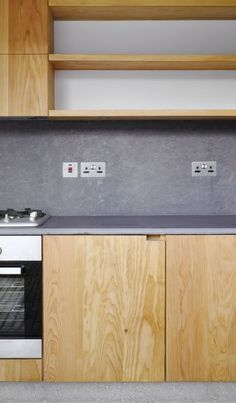 Kitchen   Concrete Wall   Open Shelving   Light Wood Cabinets   White, Grey   Natural Design