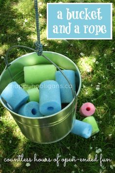 A bucket and a rope:  this simple contraption has provided hundreds of hours of open-ended, imaginative, gross-motor fun (happy hooligans) pool noodles, play spaces, buckets, rope, outdoor fun, outdoor play, play ideas, backyard play, kid