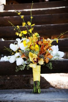Orange, Yellow, And White Bouquet    An autumnal mix of flowers includes orange, yellow, and white.