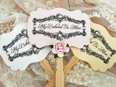 """Wedding Cupcake Toppers Song of Solomon. Wedding cupcake toppers in your choice of color and embellishments. These toppers feature a scripture from Song of Solomon - with """"I am my beloved's"""" on one side and """"my beloved is mine"""" on the reverse. The toppers are available in white, cream, and several colors of linen card stock and are mounted on a decorative bamboo food pick. Choose from pearl or rhinestone embellishments and with or without roses."""