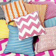 Layer up with brightly patterned throw pillows