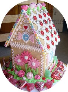 Gingerbread House - Would be cute for Spring, Easter or Valentines Day.  Love the flowers on the back of the house.