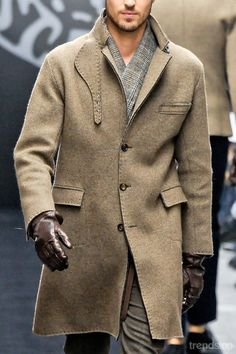 love the rough edge of the coat and the darker brown gloves.