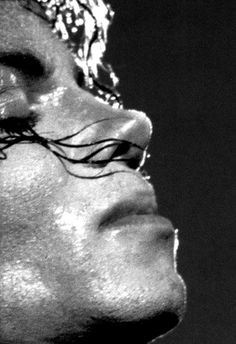 A Michael Jackson close up in black in white from a side view.