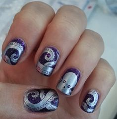 Octopus nails!  I used two images from Bundle Monster plate BM 401.  A full octopus design and another tentacle design to give the impressio...