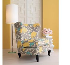 Oh my god....the segue to the new living room.  Ties the aqua cream with the gray and yellow.  I MUST FIND THIS CHAIR.