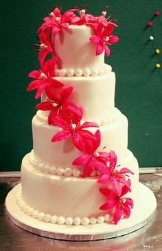 I like the arrangement of the flowers, but would use stargazer lillies, and have some black on the cake.   wedding cake with fuschia flowers, by The House of Cakes Dubai