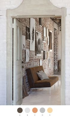 photos without frames on exposed brick